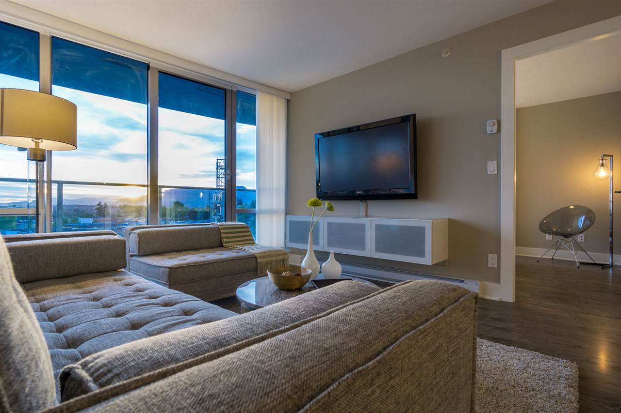 Live in Luxury at Aviara - Open, wide living room w/ floor to ceiling windows spanning entire length of wall. Plenty of natural light and magnificent views of the sunset and city. Upgraded wall TV mount and shelving already in place