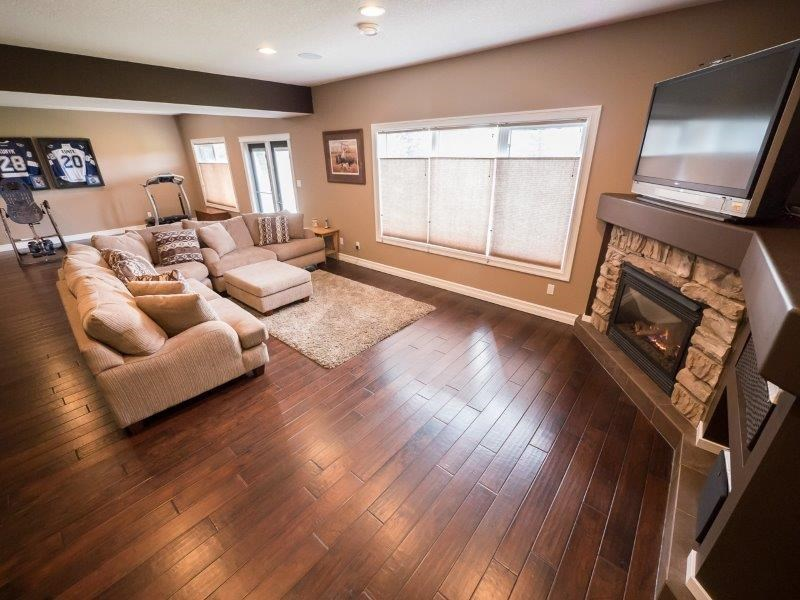Ample light cascades into the family room due to the large windows in the walk out basement.