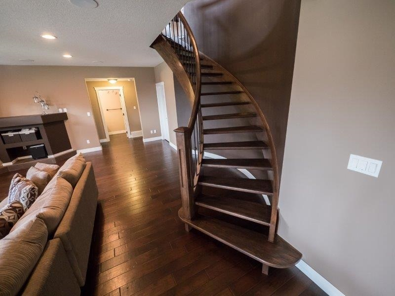 Curved staircase leading to the basement, for another touch of elegance.