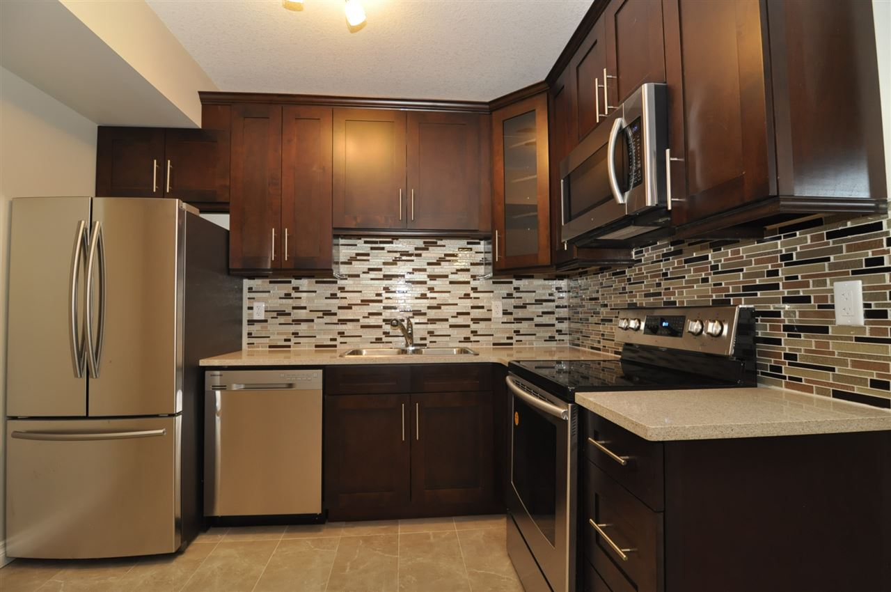 LEGAL Basement Suite Kitchen! With All The Solid Wood Cabinets, Quartz & Stainless Steel Appliances and Backsplash To Match!
