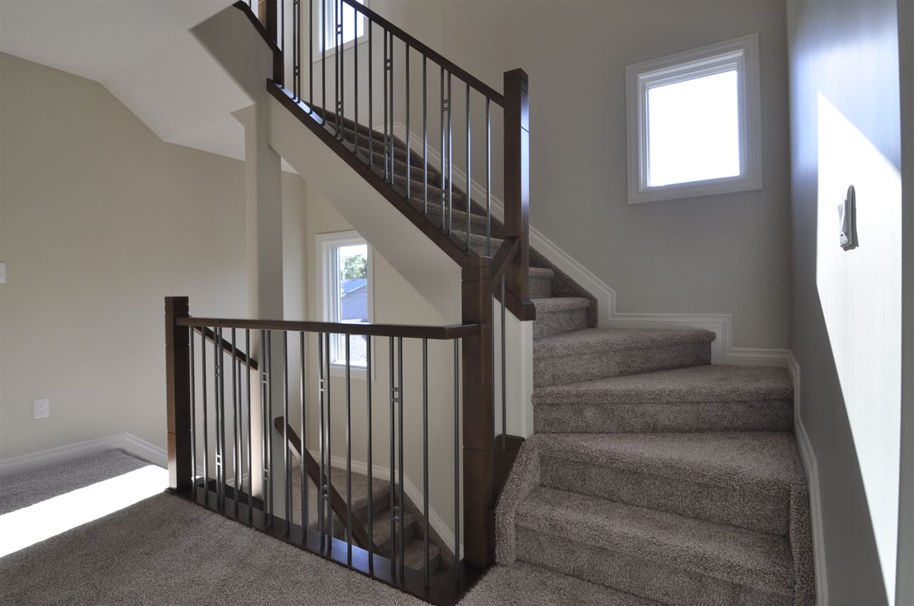 Iron Spindle Wood Stained Railing, Climbing 3 Stories!