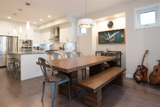 A clever bump-out helps to define the dining area in this open-concept main floor.