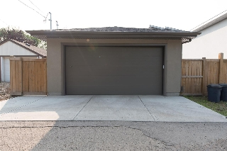 The oversized, 2 car garage is accessed through the rear-lane.