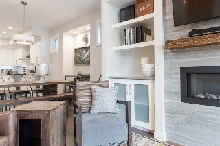 Flanking either side of the fireplace are custom built-ins complete with quartz countertops.