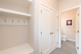 Rear mudroom, complete with built-ins, is perfect for accessing the double-car garage in back.