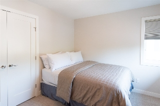 This 2nd upper level bedroom easily fits a queen-sized bed (3rd bedroom is similarly sized... not photographed).