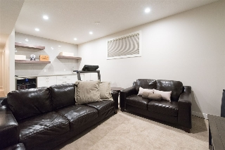 The basement living area has 9ft ceilings and large windows to maximize subterranean living. A separate entry to the basement has also been incorporated into this flexible floor plan.