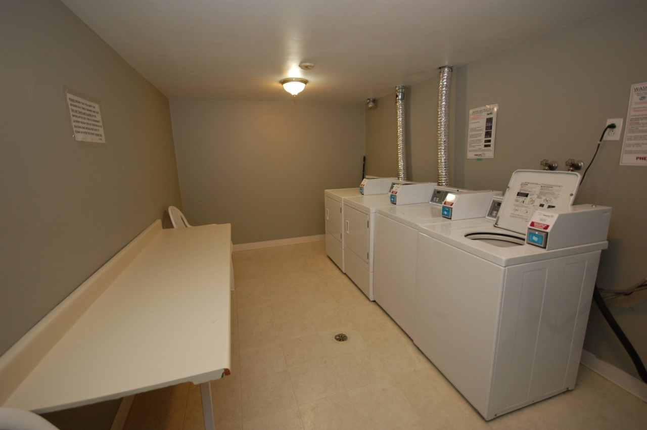 Located on the main floor this space is bright and clean.  Your laundry will be done in no time with 2 washers and 2 dryers for you to use.