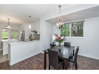 "Main Photo: 104 2000 PANORAMA Drive in Port Moody: Heritage Woods PM Townhouse for sale in ""MOUNTAINS EDGE"" : MLS®# R2257897"