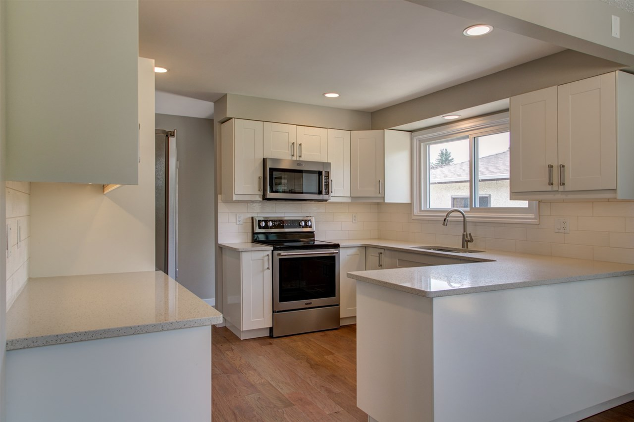 Gorgeous new kitchen featuring quartz counters, stainless steel appliances, subway tile backsplash, soft close cabinets with under lighting