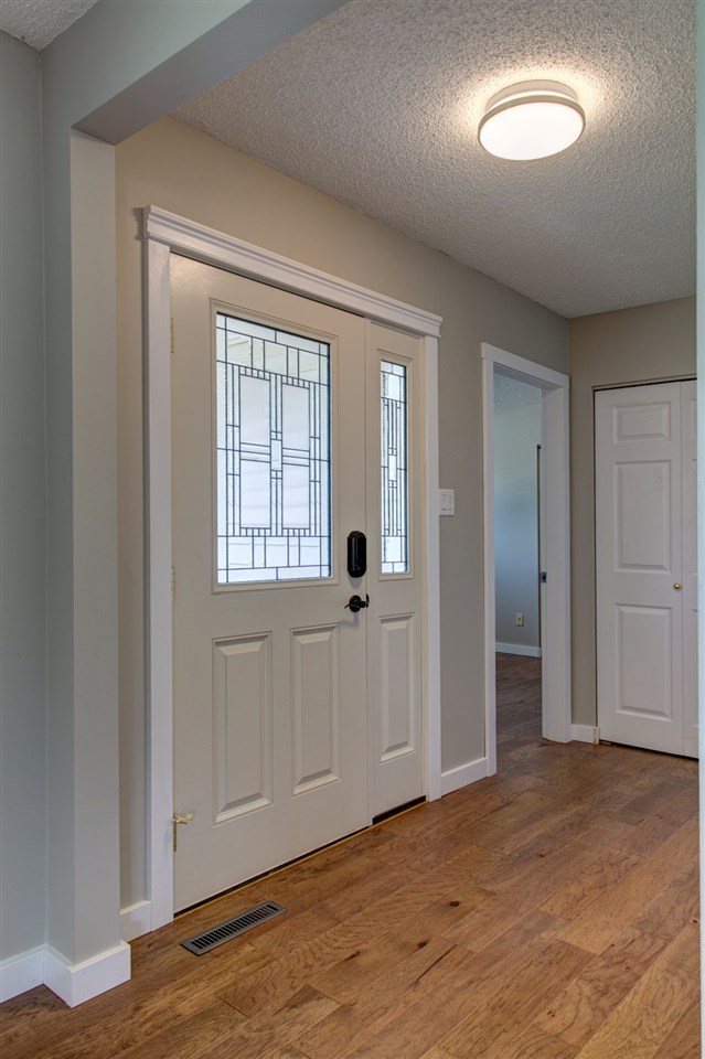 Brand new high end front door with all new engineered hardwood floors