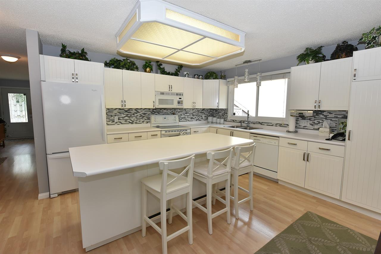 Here is a cook's kitchen complete with large island that can comfortably seat five.  All the appliances stay.