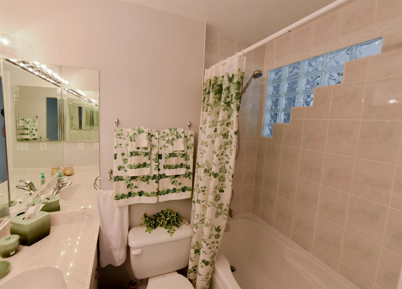 This main floor bath will impress your guests.  Note the glass bricks on the wall!