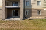 Main Photo: 7112 304 MACKENZIE Way SW: Airdrie Condo for sale : MLS® # C4130924