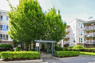 "Main Photo: 311 20200 54A Avenue in Langley: Langley City Condo for sale in ""MONTEREY GRANDE"" : MLS®# F1436676"