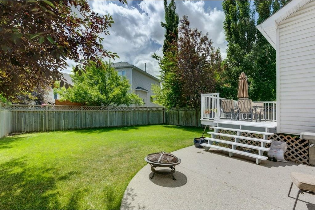Large south backyard that's great for entertaining on the deck and the aggregate patio.