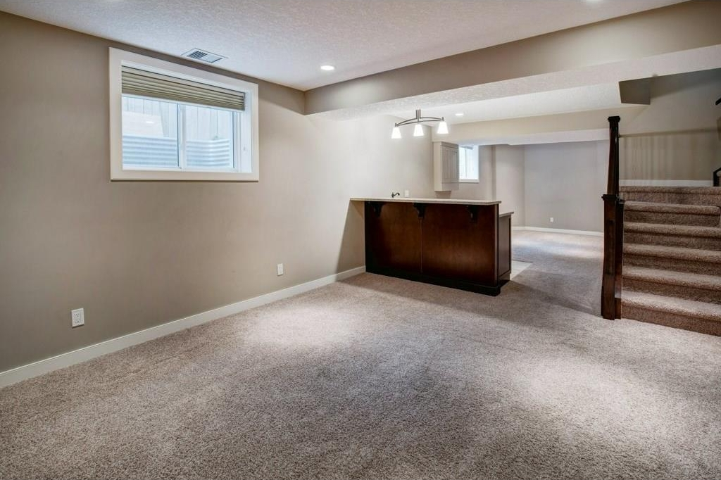 Professionally finished basement completed with modern finishes in 2013. This basement has newer carpets, stairs, balusters, windows and wells. Custom black-out blinds are great for movie nights.