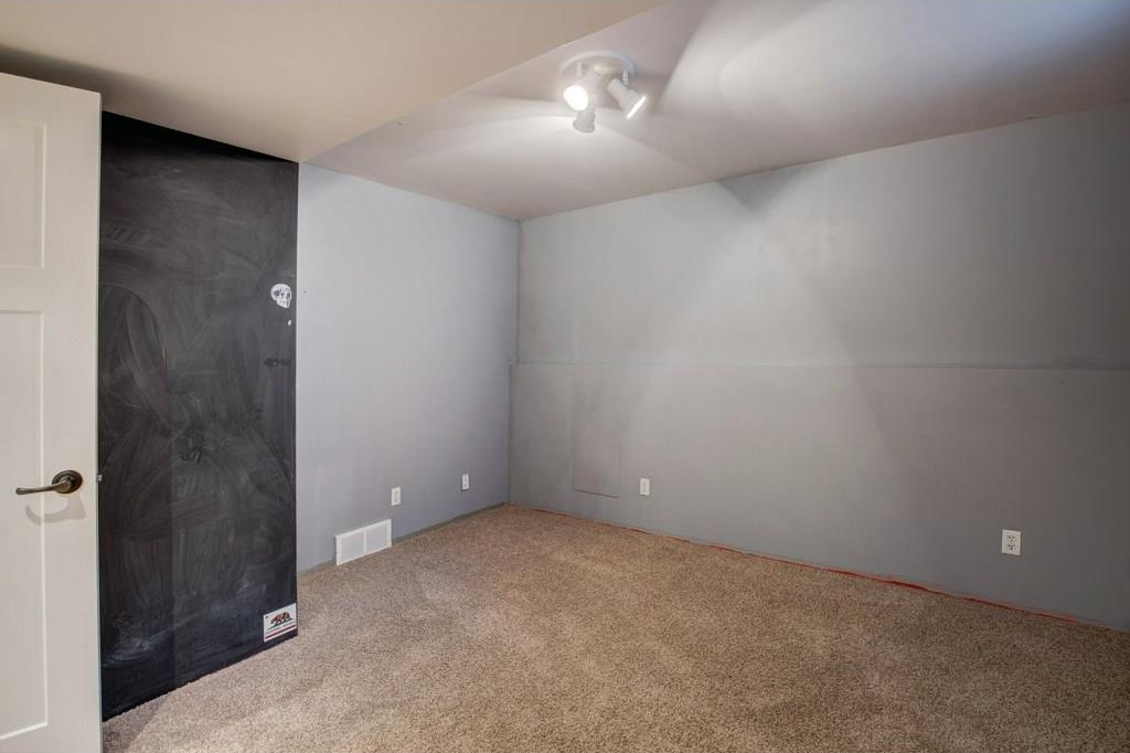 Second bedroom in the basement with newer carpets installed in 2013.