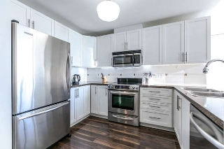 "Main Photo: 202 3880 CHATHAM Street in Richmond: Steveston Village Condo for sale in ""Chatham Place"" : MLS® # R2152334"