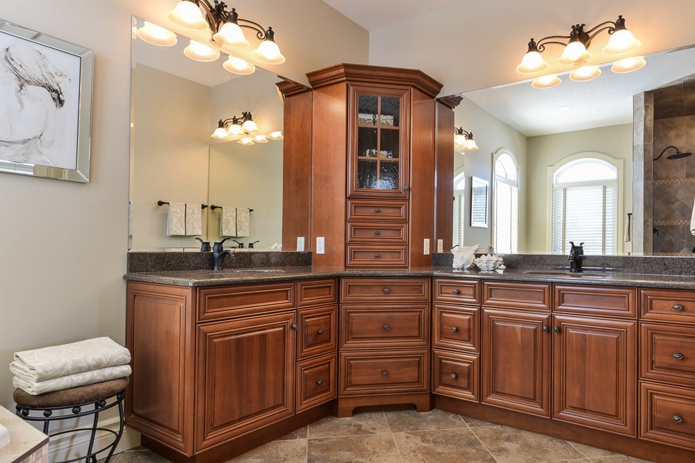 Master bath features his and hers sinks, air jetted soaker tub and glass & tile shower.
