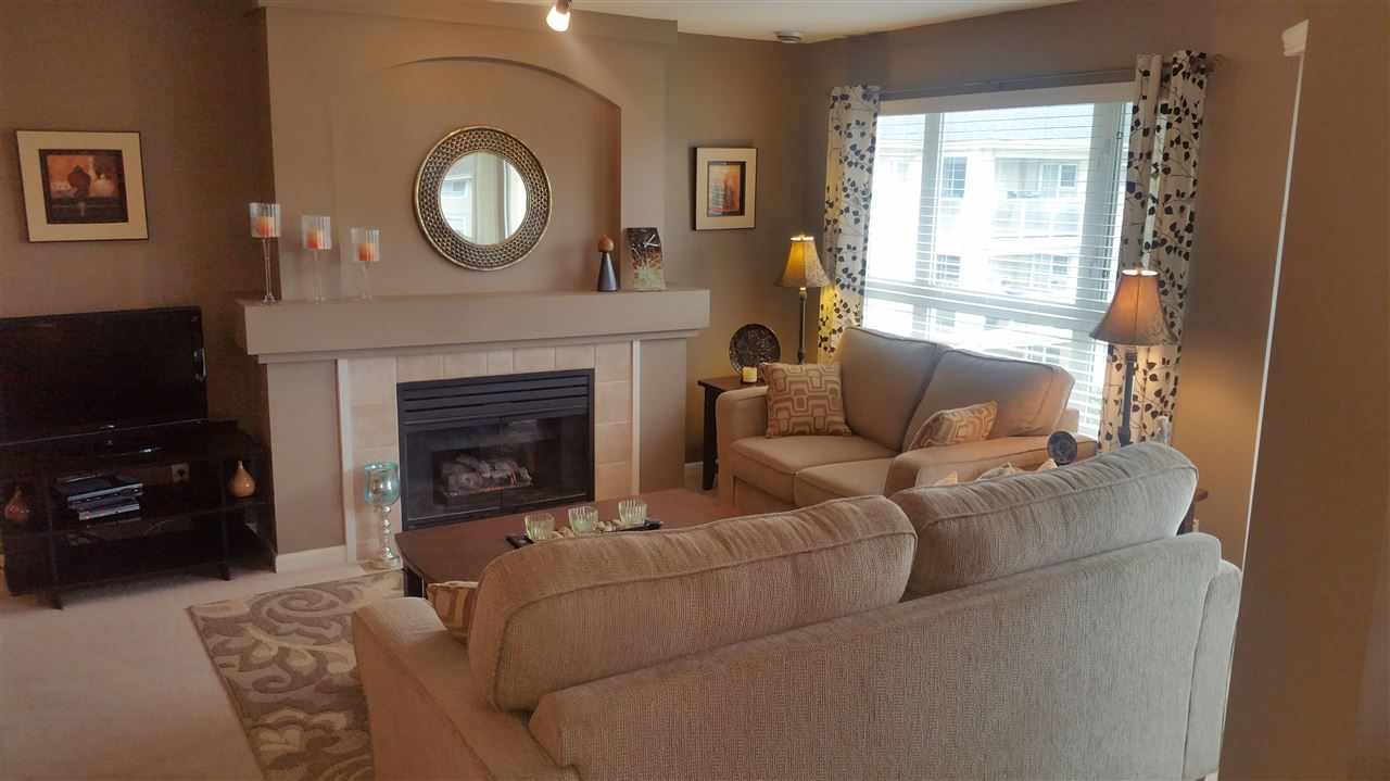 "Main Photo: 312 20125 55A Avenue in Langley: Langley City Condo for sale in ""Blackberry Lane II"" : MLS(r) # R2181558"