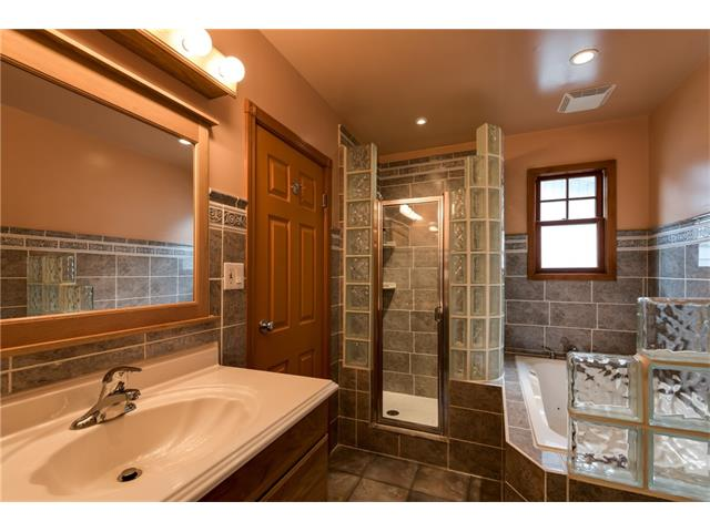 Large bathroom with beautiful glass blocks, spacious shower and jetted soaker tub!