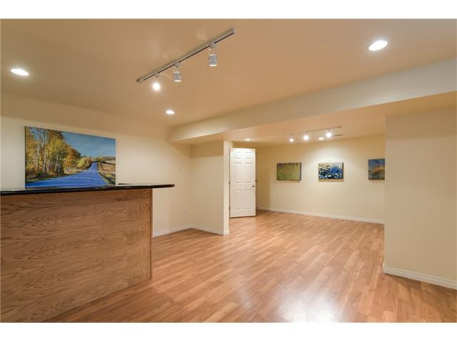 Newly finished basement is bright and spacious with laminate flooring, pot lighting and a bar!