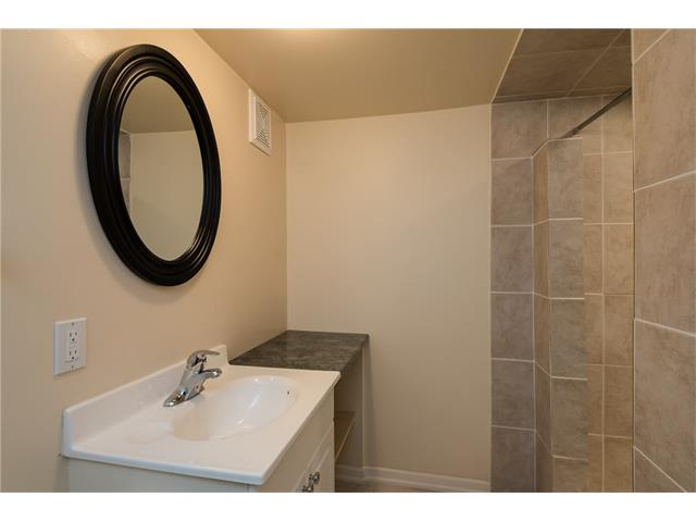 3-piece basement bathroom comes complete with a tiled stand-up shower.