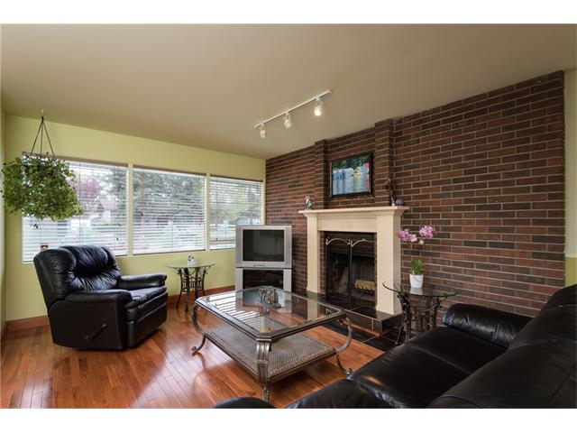 Great sized living room with cozy wood burning fireplace and a beautiful brick feature wall!