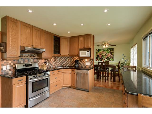 Huge kitchen with granite countertops and stainless steel appliances (including gas range!)