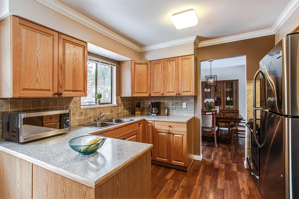 Photo 2: 3271 NORFOLK Street in Port Coquitlam: Lincoln Park PQ House for sale : MLS® # R2139122