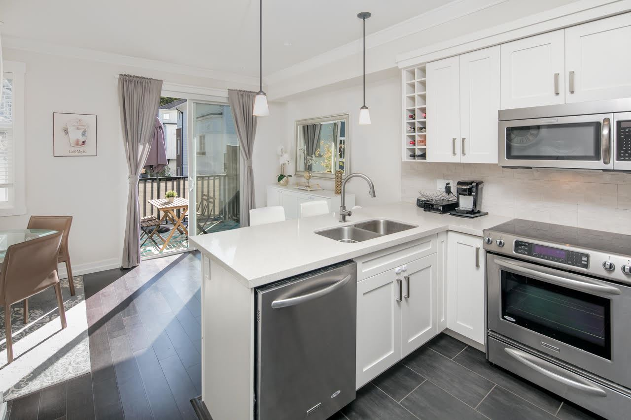 the townhouse guy trevor brucki realtor white rock south bright functional kitchen with stainless appliances double undermount sinks beautiful backsplash stylish stylish white cabinets