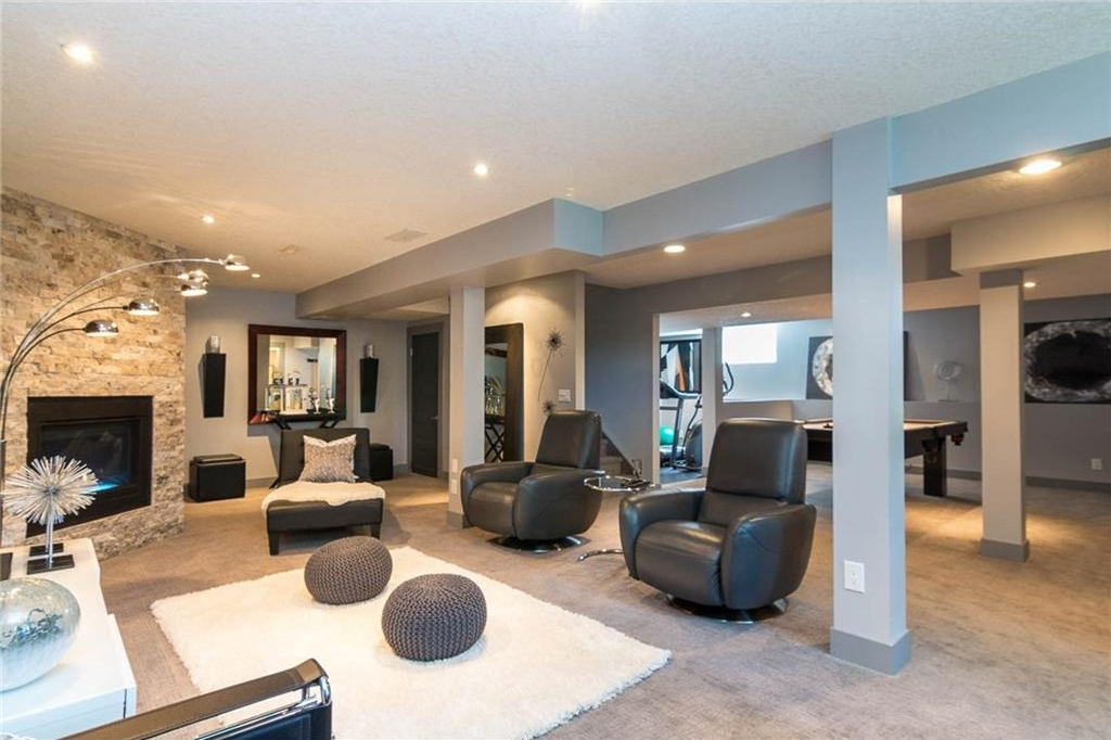 The lower level has been recently & totally renovated...high end carpet, gas fireplace with natural stone surround, media room, games room, wet bar & gym.