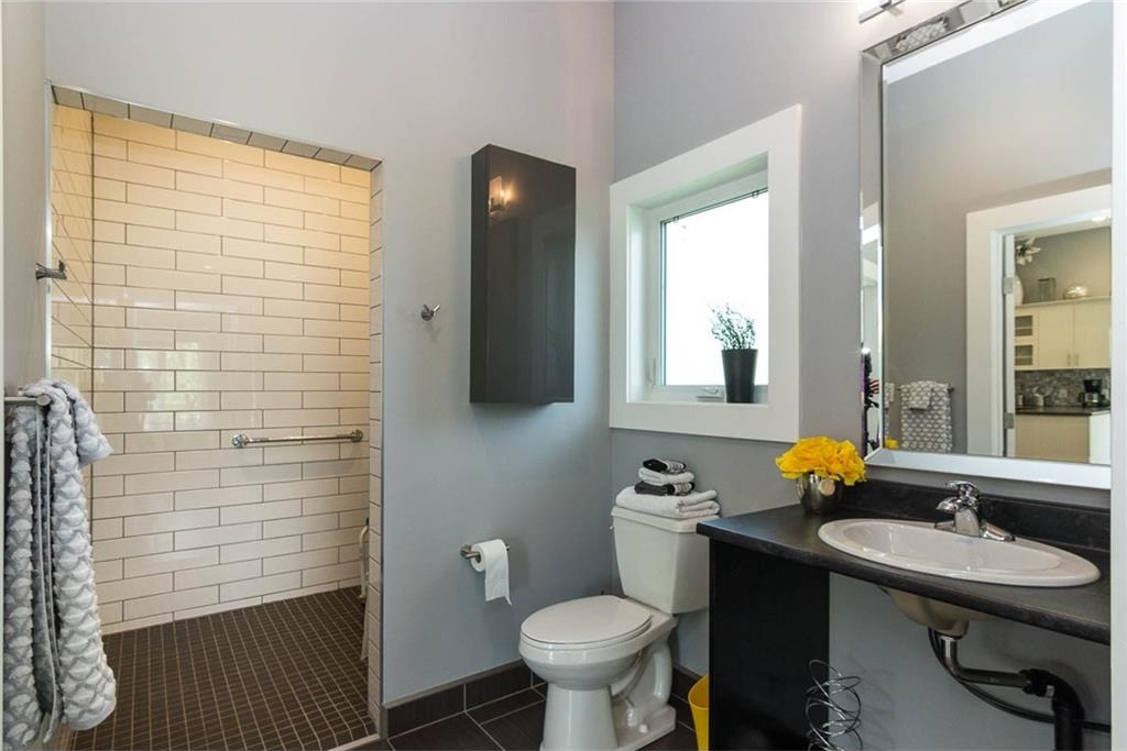 Large bathroom with tile floor & curbless tile shower.