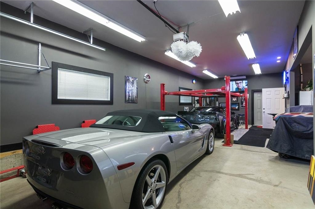 This garage is fantastic...shown is the oversized tandem bay with car lift.
