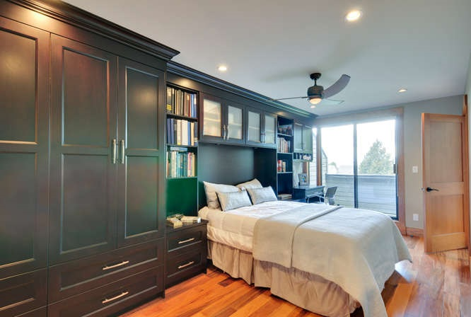 Great use of space with built in queen bed, office desk & plenty of closets