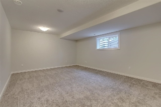 Basement rec/family room is very spacious and perfect for a theatre / entertainment room