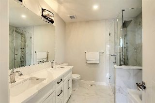 5 Pce palatial ensuite bath has huge walk-in shower with body sprays and rainfall shower head, separate soaker tub and 2 sinks with beautiful Quartz counters.