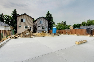 Double detached garage being constructed will have shared wall with neighboring garage