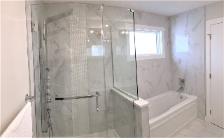 Huge walk-in shower with body sprays, hand shower and rainfall shower head, separate soaker tub