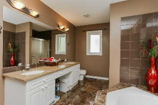 Double sinks, granite countertops, separate shower and Jacuzzi bathtub!
