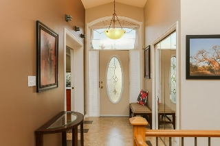 Bright foyer with 12ft ceilings