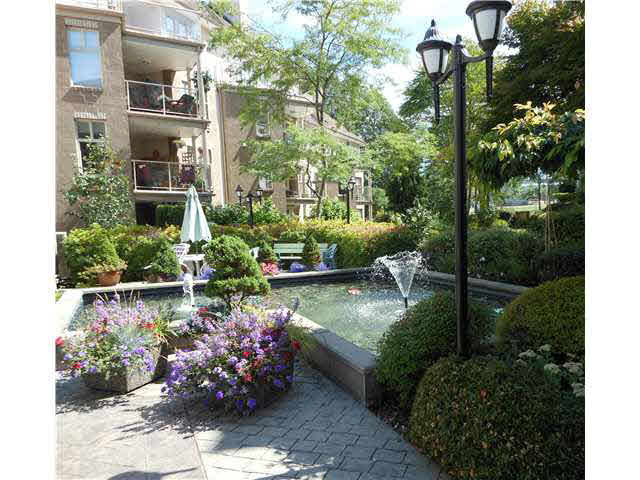 "Main Photo: 102 15340 19A Avenue in Surrey: King George Corridor Condo for sale in ""STRATFORD GARDENS"" (South Surrey White Rock)  : MLS®# F1447410"