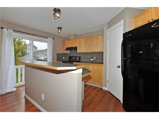 Photo 7: 32 TUSCANY RIDGE Way NW in Calgary: Tuscany House for sale : MLS(r) # C4086936