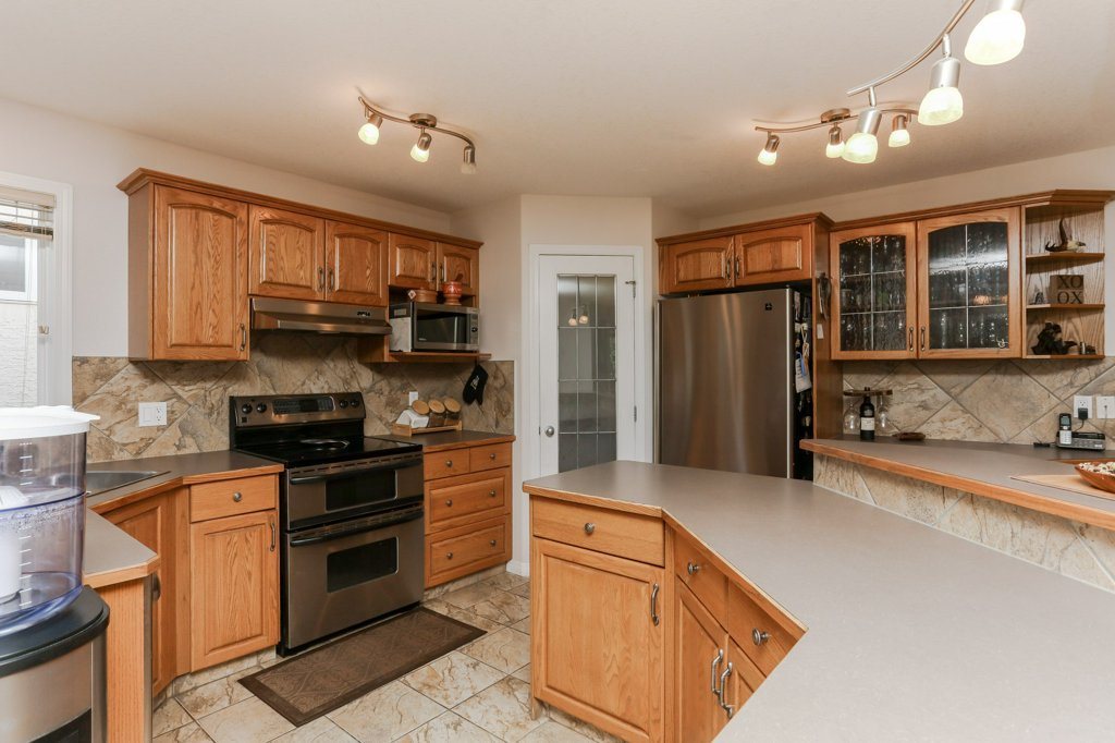 Photo 10: 657 SILVER BERRY Road in Edmonton: Zone 30 House for sale : MLS(r) # E4072951