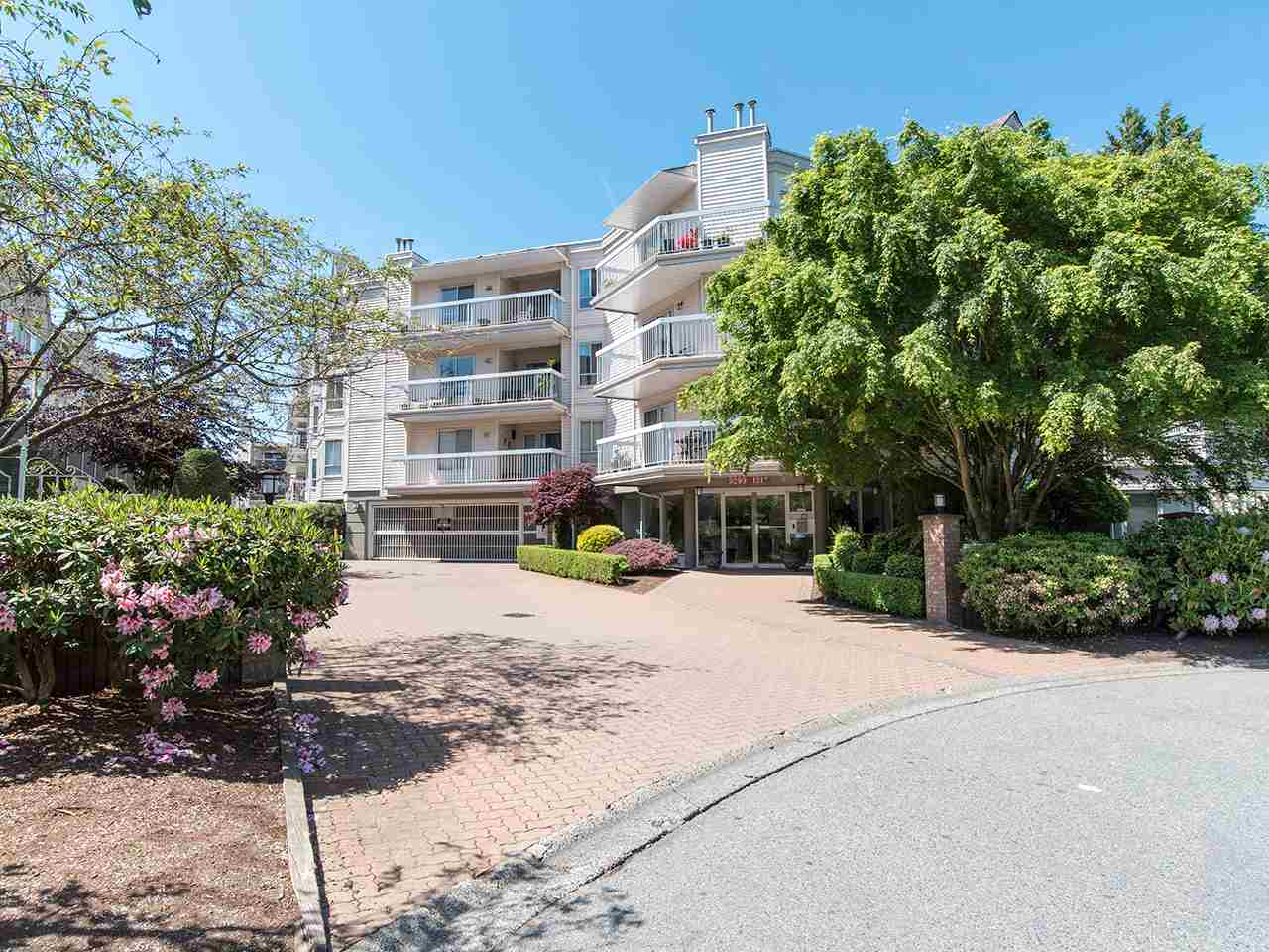 "Main Photo: 304 9299 121 Street in Surrey: Queen Mary Park Surrey Condo for sale in ""Huntington Gate"" : MLS®# R2268707"
