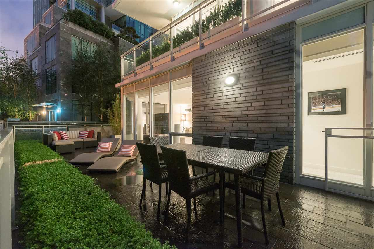 generous patio with direct in and out access to the seawall