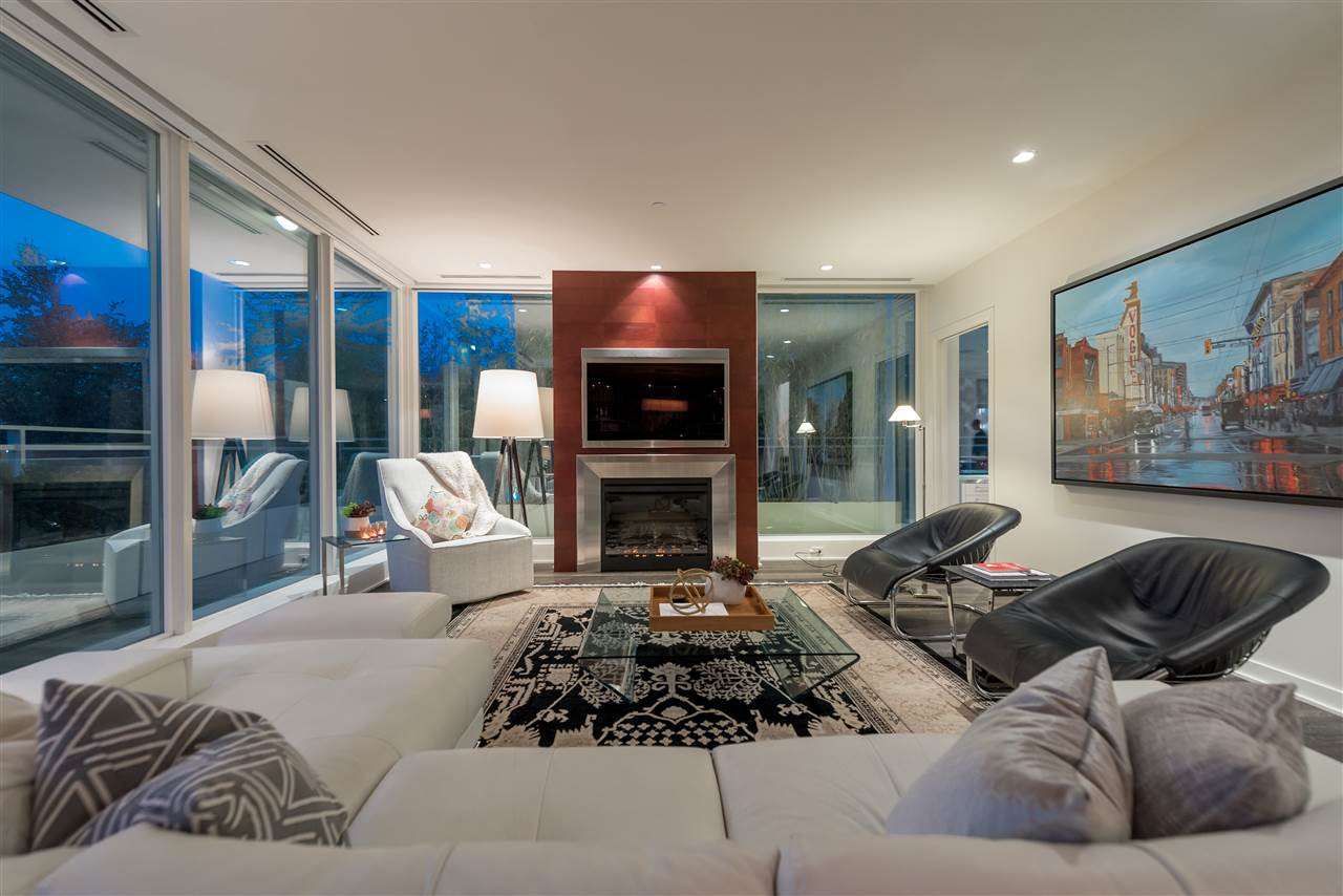 oceanfront living room with walk out terrace