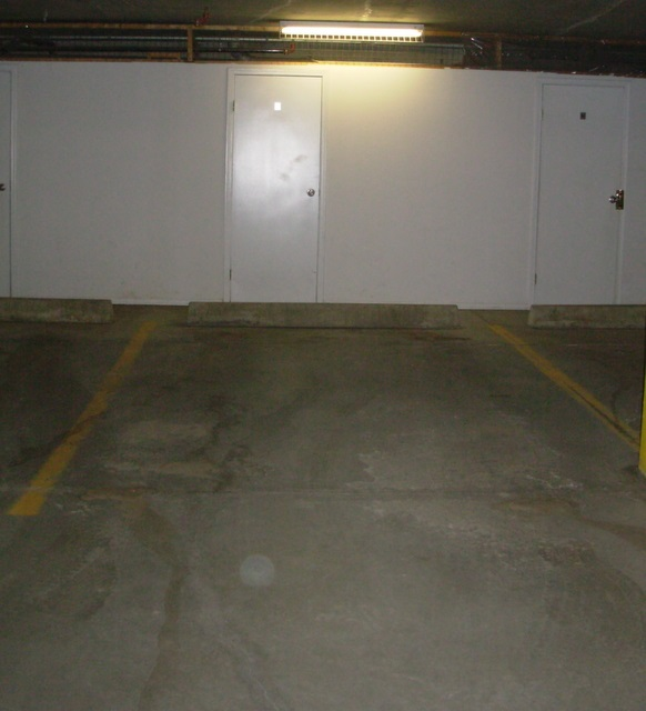 Heated underground titled parking space with a good sized storage locker.