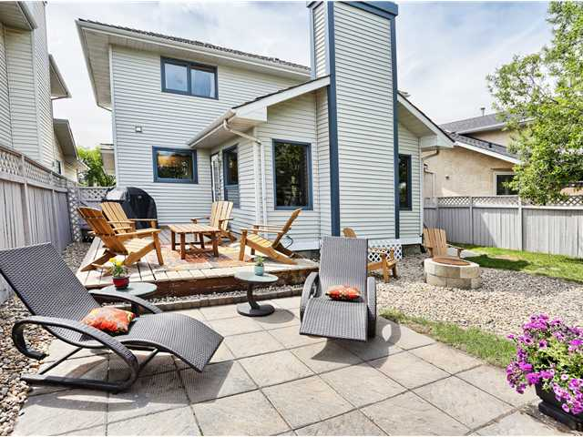Low maintenance family friendly backyard offering both a patio and a deck
